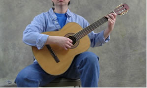 Holding the Guitar - Sitting Position - Classical Left Leg