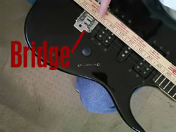 Measuring guitar scale with a yard stick - bridge
