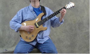 Holding the Guitar - Sitting Position - Classical Electric With Strap