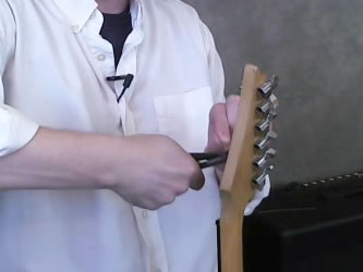 Clip off the excess guitar string