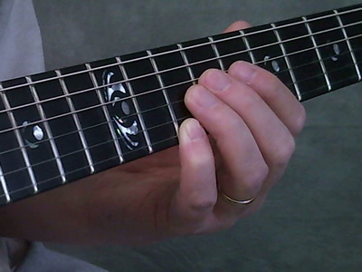 Muting Surrounding Strings With Other Fingers